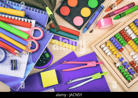 Variety of school supplies on wooden background - Stock Photo
