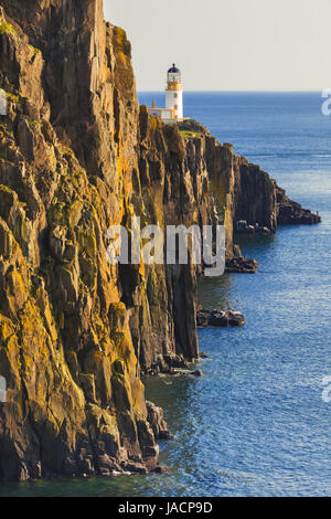 A look at Lighthouse on the cliffs of Neist Point, rugged and rocky coast on the western side Isle of Skye. Famous - Stock Photo