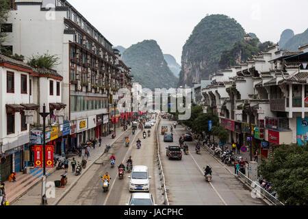 Yangshuo, China.  Street Scene, Karst Landscape in Background. - Stock Photo