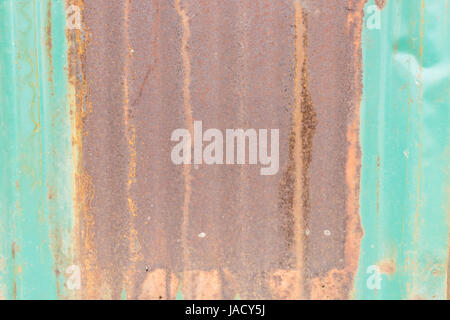 Full frame close-up of the rusty Damaged Corrugated Metal Rusted Surface Background - Stock Photo