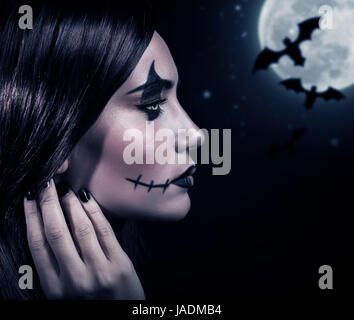 Side view of terrifying witch in Halloween night, bats on full moon background, portrait of werewolf on scary dark - Stock Photo