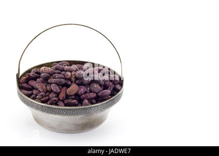 Red beans in antique silver bowl isolated on white background - Stock Photo