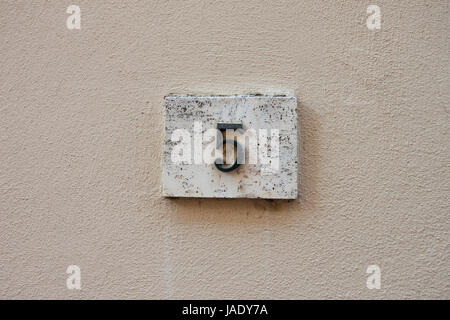 three dimensional house number five. Black lettering on a white background. - Stock Photo