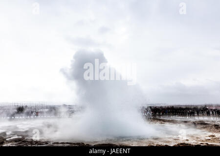 Erupting of the Great Geysir lies in Haukadalur valley on the slopes of Laugarfjall hill. Erlie morning in Southwestern - Stock Photo