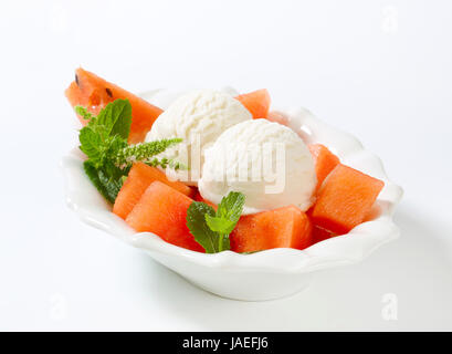 Two scoops of white ice cream with watermelon - Stock Photo