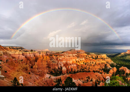 sunset rainbow over bryce canyon - Stock Photo