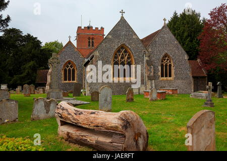 The lovely local Church in the quiet village of Hurst near Twyford with its old tree bench and mowed grass all very - Stock Photo