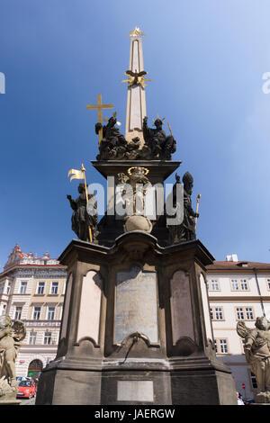 The Column of the Holy Trinity (Morový Sloup Nejsvĕtĕjší Trojice) is a Baroque plague column on Malostranské Square - Stock Photo