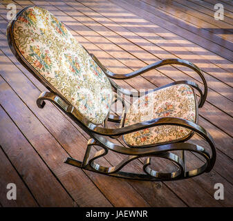 The rocking chair is on the terrace of a private house. - Stock Photo
