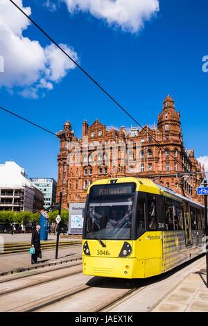 Metrolink tram passing the Midland Hotel, Manchester, England, U.K. - Stock Photo