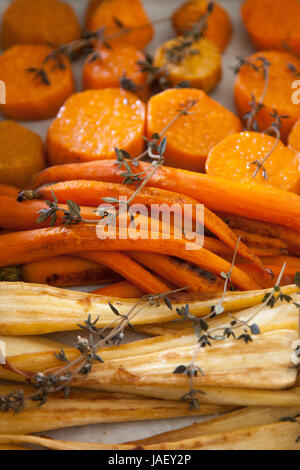Roasted carrots served in a plate. - Stock Photo