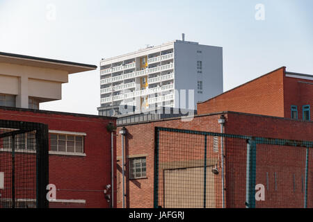 Council housing high rise flats in East London surrounded by red brick industrial looking buildings - Stock Photo