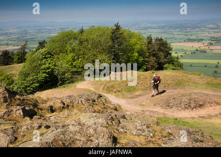 UK, England, Shropshire, The Wrekin, walker on Shropshire Way path descending south eastern ridge - Stock Photo