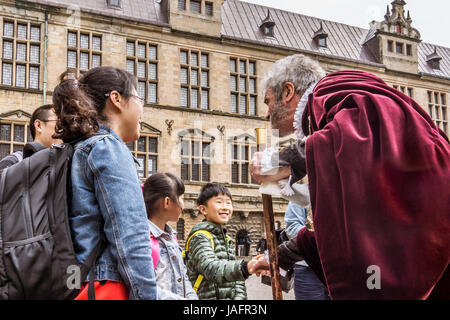 Asian family at Kronborg castle talking to an actor, Elsinore, Denmark, May 30, 2017 - Stock Photo