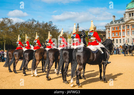 The Royal Guards in red uniform on horses, The Life Guards, Household Cavalry Mounted Regiment, parade ground Horse - Stock Photo