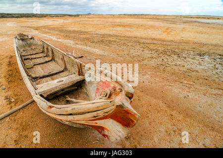 A canoe in the desert region of La Guajira in Colombia - Stock Photo