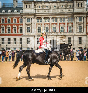 Royal Guard in red uniform on horse, The Life Guards, Household Cavalry Mounted Regiment, parade ground Horse Guards - Stock Photo