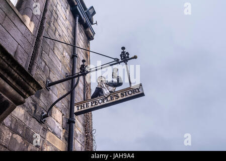 Sign outside the People's Story Museum, a museum housed in the historic Canongate Tolbooth, which tell the story - Stock Photo