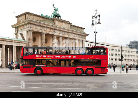 BERLIN, GERMANY - OCTOBER 17: Sightseeing tour bus near Brandenburg gate in Berlin on October 17, 2013. The Gate - Stock Photo