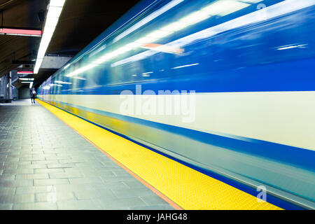 Colorful Underground Subway Train and Platform with motion blur - Stock Photo