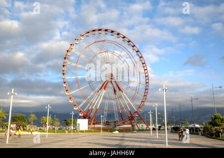 Panoramic ferris wheel in the Park of Miracles on the embankment. Batumi, Georgia - Stock Photo