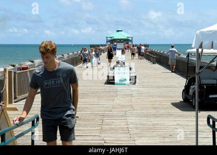 Stock photo of tourists walking on Folly Beach Fishing Pier Charleston, South Carolina, USA. - Stock Photo