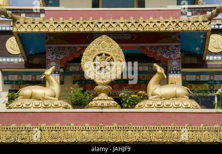 Buddhist icons deer and Dharma Chakra at Namdroling Monastery in Bylakuppe, near Kushalnagar, Mysore District, Karnataka, - Stock Photo
