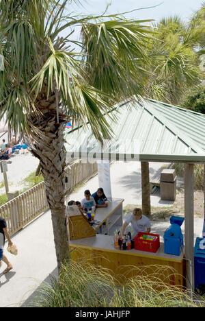 Couple getting a drink at Folly Beach in Charleston, South Carolina, USA.