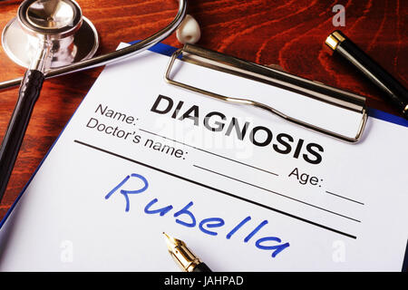 Medical form with diagnosis Rubella on a clipboard. - Stock Photo