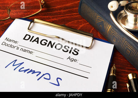 Medical form with diagnosis Mumps on a table. - Stock Photo