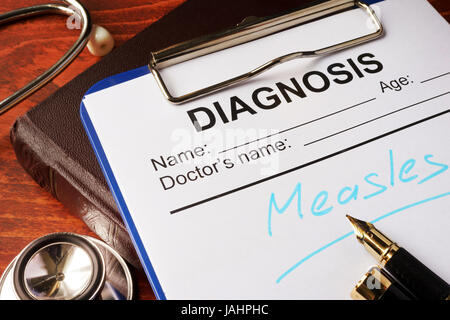 Medical form with diagnosis Measles on a table. - Stock Photo