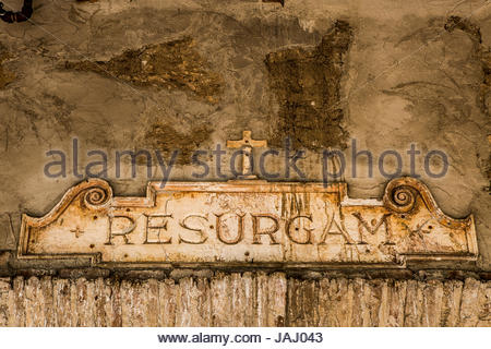 A tablet over a door at the Mission San Juan Capistrano in California. 'Resurgam' translates from the Latin as, - Stock Photo
