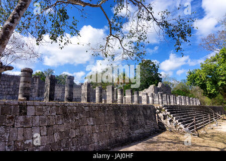View of the temple of a thousand warriors in the ancient Mayan ruins of Chichen Itza in Mexico - Stock Photo
