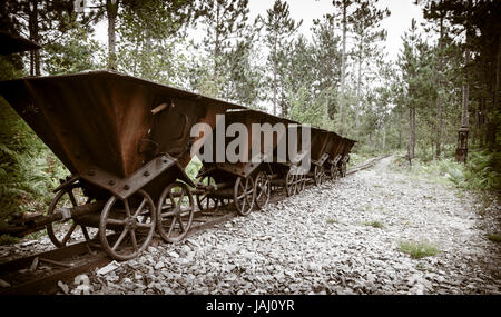Old ore carts at an abandoned mine on Upper Peninsula, Michigan - Stock Photo