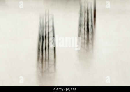 Motion picture of ruined wood frames in the water - Stock Photo