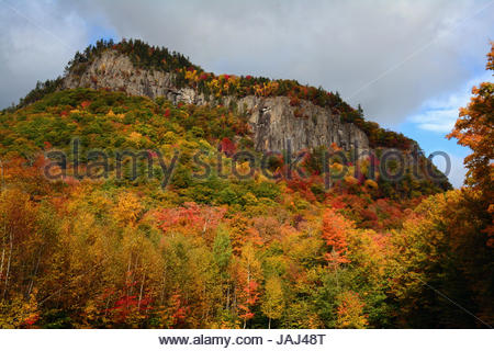 Scenic view of fall foliage and exposed rock on a hillside in the White Mountains, New Hampshire. - Stock Photo