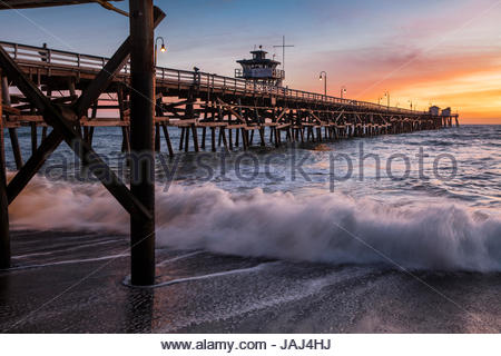 The 1,296 foot long wooden pleasure pier in San Clemente, California, at sunset. - Stock Photo