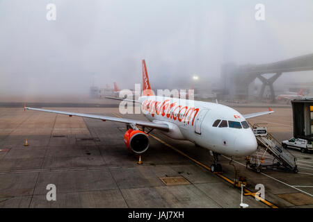A Easy Jet Plane On The Ground In The Fog At London Gatwick Airport, West Sussex, UK - Stock Photo