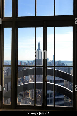 Look through Window at Empire State Building from Top of the Rock, Rockefeller Center, Manhattan, New York City - Stock Photo