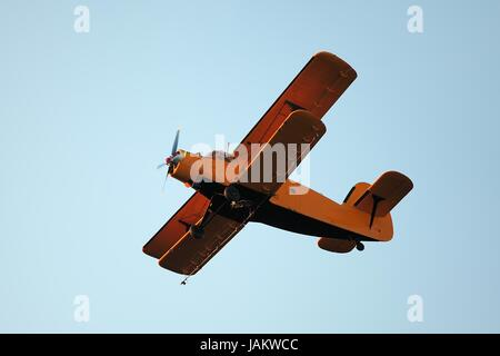 Old airplane against blue sky - Stock Photo