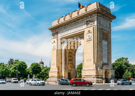 BUCHAREST, ROMANIA - MAY 24, 2017: Built in 1936 Arcul de Triumf is a triumphal arch located in the northern part - Stock Photo
