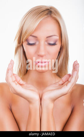 Closeup female opened hands on a white background - Stock Photo