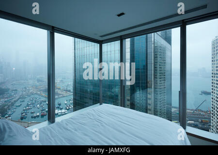 View over Causeway Bay and Hong Kong Island from Twenty One Whitfield Boutique Hotel, Hong Kong, China - Stock Photo