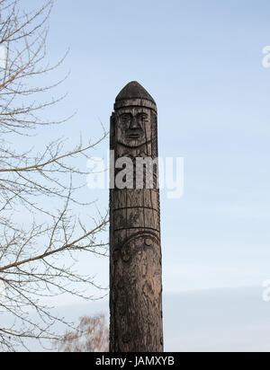 wooden statue of the Slavic god Perun. Dubno, Ukraine - Stock Photo