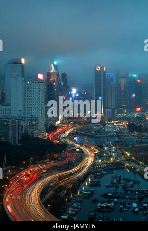 Island Eastern Corridor Motorway, Causeway Bay, and high-rises of Wan Chai and Central, Hong Kong, China - Stock Photo