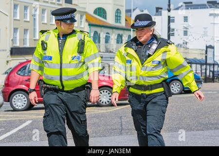 PCSO. Police Community Support Officers patrolling along the seafront promenade in West Sussex, UK.