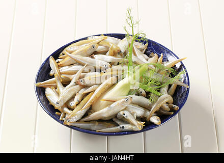 Bowl of fresh sprats with fennel - Stock Photo