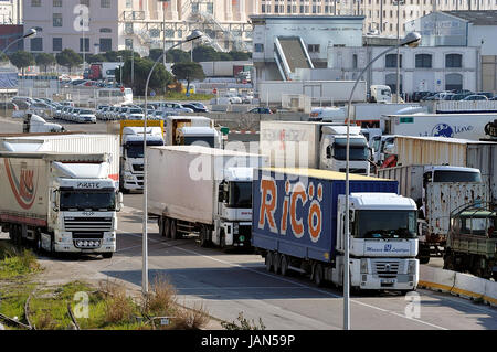 FOS-SUR-MER - FRANCE – MARCH 7, 2011: Road traffic of the trucks on the wearing of Fos-sur-Mer beside Marseilles - Stock Photo