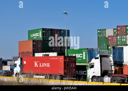 FOS-SUR-MER - FRANCE – MARCH 8, 2011: Trucks moving the containers to bring them to the quay of loading to be charged - Stock Photo