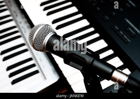 microphone and piano keyboards background - Stock Photo